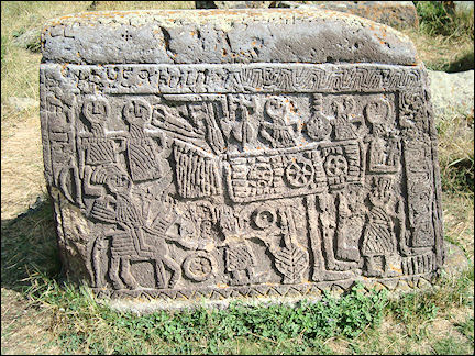 Armenia - Khachkar in Noratus with scene of a party