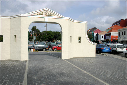Netherlands Antilles, Curaçao - Willemstad, a piece of city wall, small and out of place between the parked cars