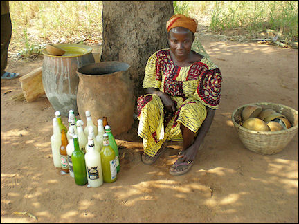 Burkina Faso - A cabaret with palm wine (banji) vendor