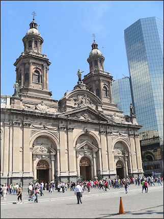Chile - Santiago, cathedral next to glass office tower on Plaza de Armas