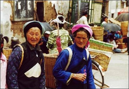 China, Yunnan - Huize, women in traditional garb