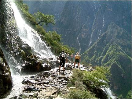 China, Yunnan - Tiger Leaping Gorge, crossing a waterfall