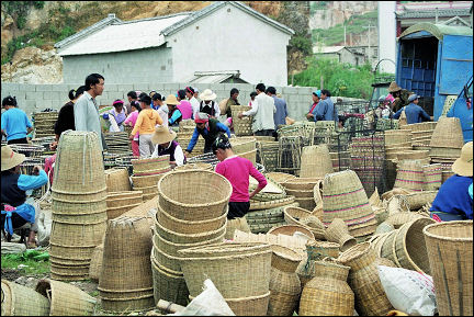 China, Yunnan - Woven baskets in the week market