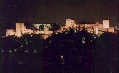 Spain, Andalusia, Granada - The Alhambra at night from Mirador S. Nicolás