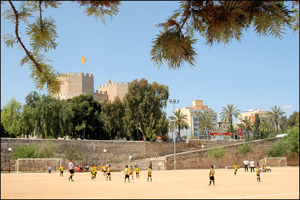 Spain, Valencia - Soccerfield in Turia Park and Torres de Serranos