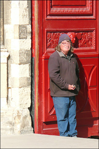 France, Normandy - Beggar at the cathedral door