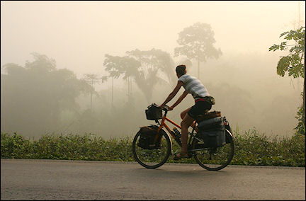 Ghana, Tarkwa-Butre - Bicycling in the morning fog