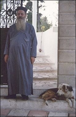 Greece, Corfu - Monk at monastery gate, Paleokastritsa