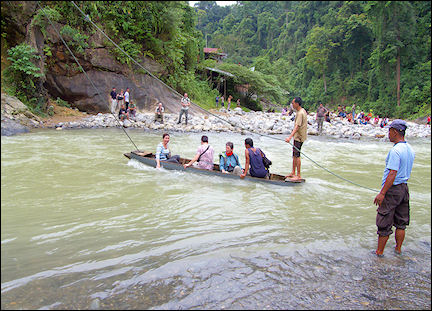 Indonesia, Sumatra - Crossing a river in a canoe on a long rope