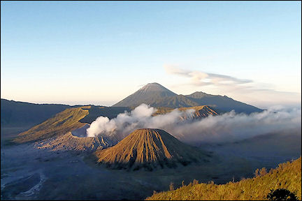 Indonesia, Java - The Semeru volcano spits out a large plume of smoke every 20 minutes
