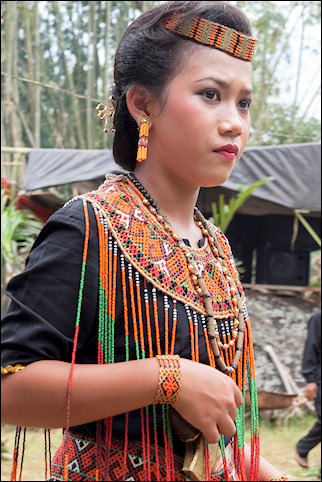 Indonesia, South Sulawesi - Rantepao, traditionally dressed woman at mourning ceremony