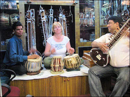 India, Agra - Playin music on tabla and sitar