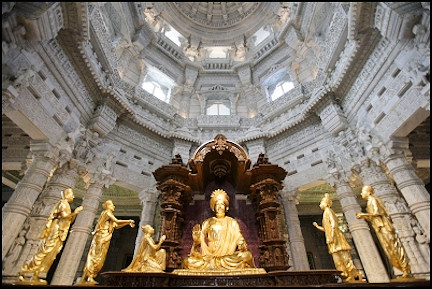 India, Delhi - The central dome of Akshardhaam complex with gold plated statues of Lord Swaminarayan and his devotees