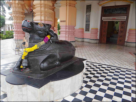 India, Delhi - Statue of the bull Nandi outside Shiv Gauri Nageshwar Temple
