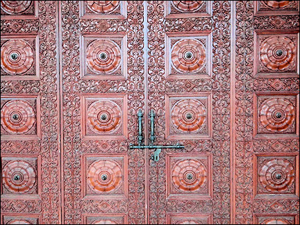 India, Delhi - Fine craftsmanship on the wooden gates of Laxmi Vinayak Temple