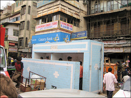 India - Public bathroom in a crowded street in Old Delhi