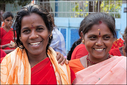 India, Tamil Nadu - Trichy, Female pilgrims dressed in red