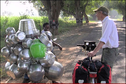 India, Tamil Nadu - Aart talks with a pots-and-pans vendor
