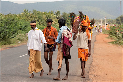 India, Tamil Nadu - Pilgrims walking along the road