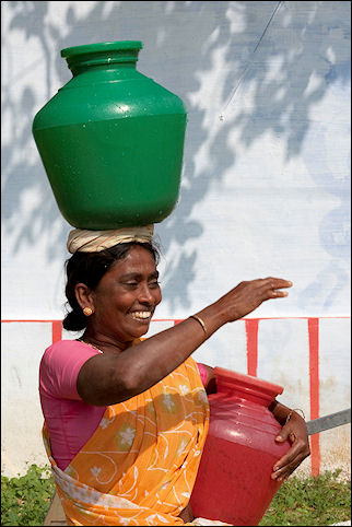 India, Tamil Nadu - Woman with water jugs