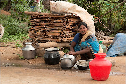 India, Kerala and Karnataka - Woman cleaning pots