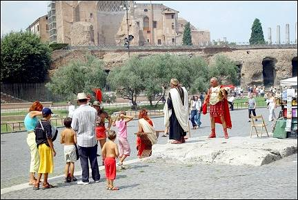 Italy, Rome - Romans outside the Coloseum