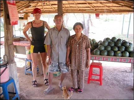 Bicycle vacation Cambodia - Gerrie with owners stall
