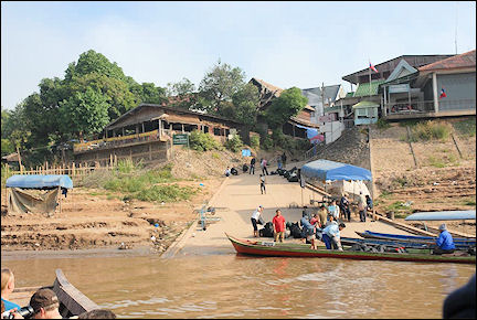 Laos - Arrival by boat at the Laotian border