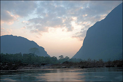 Laos - Ou river early in the morning with karst mountains