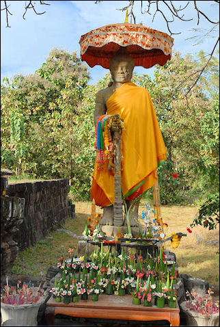 Laos - Buddha with sacrificial table in Wat Phu temple complex