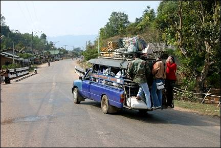 Laos - Vang Vieng, pick-up truck with load and passengers