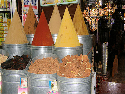 Morocco, Marrakech - Brightly colored spices in tall cone-shaped stacks at the souk