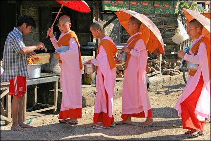 Myanmar - Nuns with parasols waiting in line