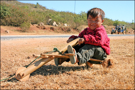 Myanmar, Yangon - Boy on home-made tricycle