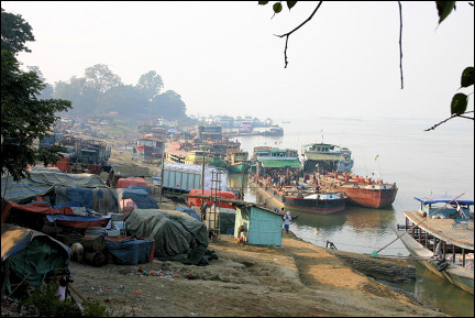Myanmar, Pathein - Riverbank with boats