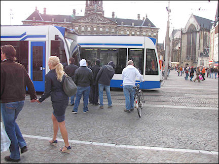 Netherlands, Amsterdam - The GVB tram passes through the crowd like a whale...