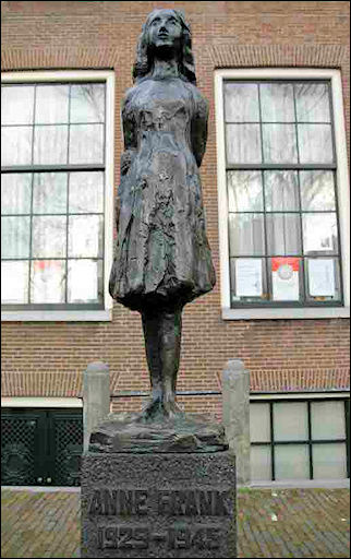 Netherlands, Amsterdam - Statue of Anne Frank in front of Anne Frank House