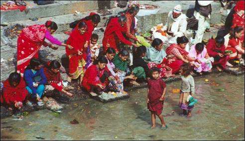 Nepal, Ganesh Himal Trek - People throw flowers in the river