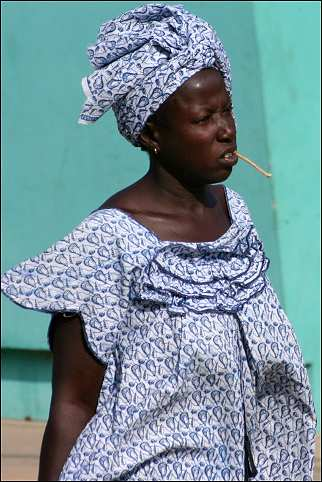 Senegal - Kaolack, woman with piece of wood in her mouth