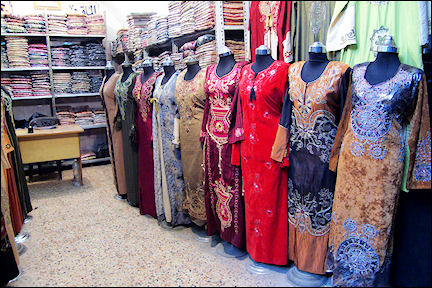 Syria, Aleppo - Clothes store in the souk