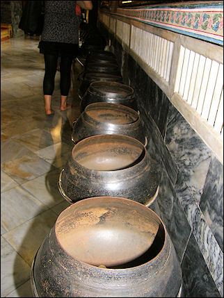 Thailand - Bangkok, metal pots with coins in Wat Arun