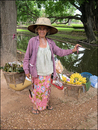 Thailand - Sukhothai, woman with yoke