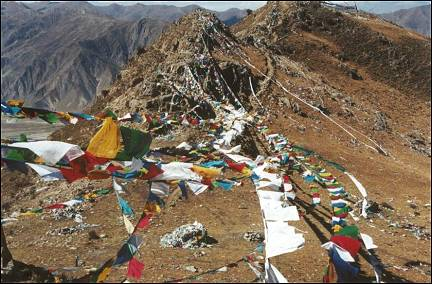 Tibet - Prayer flags on mountain top