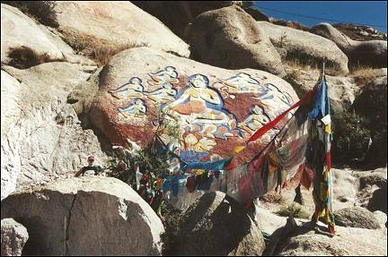 Tibet - Prayer flags and rock paintings