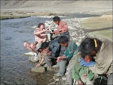 Tibet - Bathing in the river together