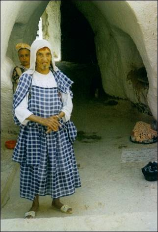 Tunesia - Mother Fatma in front of her cave dwelling