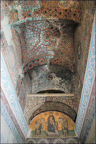 Turkey - Istanbul, Aya Sofia: in the background, a Byzantine depiction of the holy family, in the foreground the ceiling with abstact islamic decorations