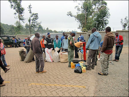 Tanzania - Porters in line for the scales