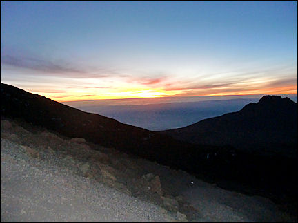 Tanzania - Sunrise during hike to the top