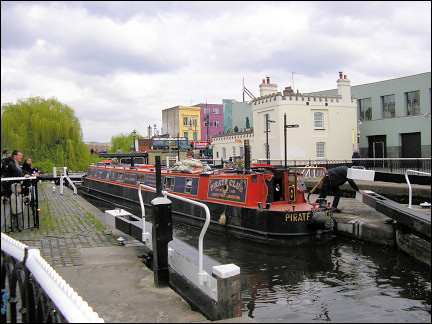 United Kingdom, London - Narrowboat passes through lock